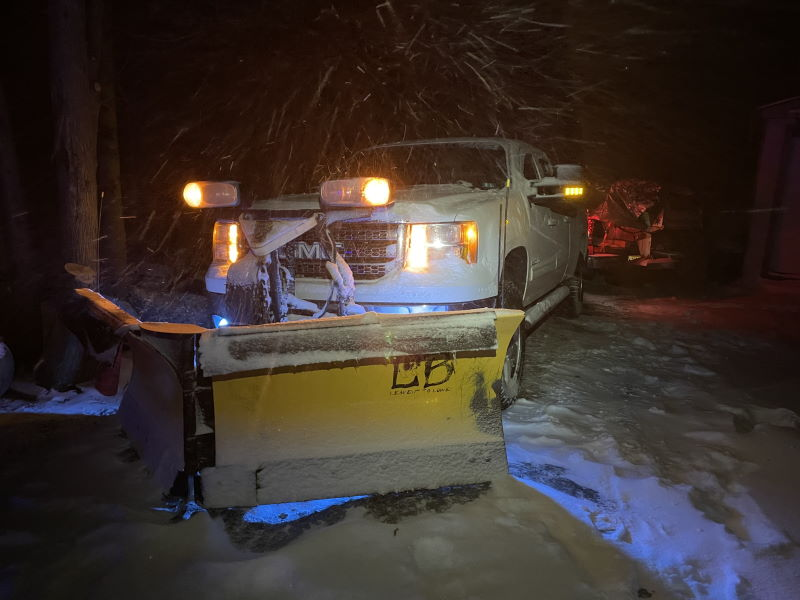 lowe basset winter plowing at night